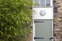 Clock on converted barn door