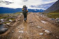 Mari backpacker walking on dirt path