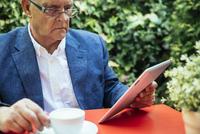 Hispanic businessman using digital tablet