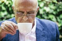 Hispanic businessman drinking cup of coffee