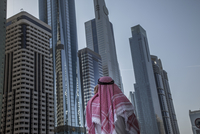 Pakistani man admiring highrise buildings in Dubai cityscape, Dubai Emirate, United Arab Emirates