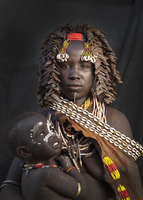 Black mother and daughter wearing traditional jewelry