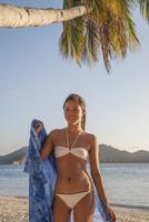 Asian woman wearing bikini on beach