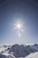 Sunshine over snowy mountaintops