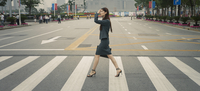 Chinese businesswoman in pedestrian crossing