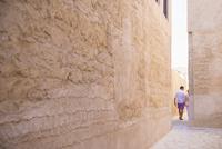 Caucasian couple walking in alley