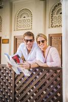 Caucasian couple reading map