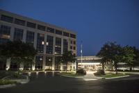 Illuminated driveway of hospital at night