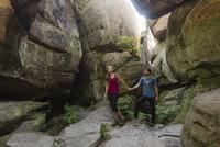 Caucasian couple exploring cave