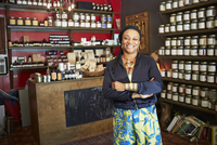 Black woman smiling in tea shop