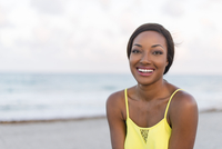 Black woman smiling on beach