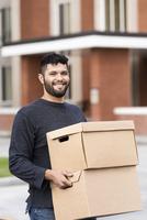 Hispanic college student moving into dormitory