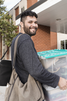 Hispanic college student moving into dormitory