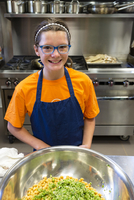 Student smiling in cooking class