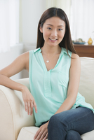 Chinese woman sitting on sofa