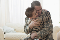 Caucasian soldier hugging son