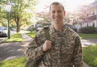 Caucasian soldier standing in neighborhood