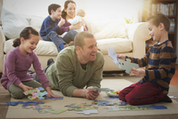 Caucasian father and children playing in living room