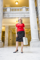 Caucasian businesswoman with briefcase in courthouse