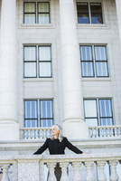 Caucasian businesswoman standing outside courthouse