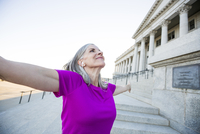 Caucasian woman standing outside courthouse