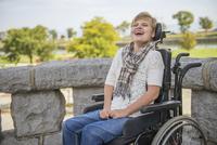 Paraplegic woman laughing in wheelchair