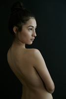 Nude Hispanic woman looking away