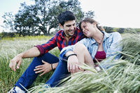 Couple sitting in field