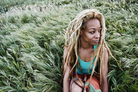 Black woman sitting in grass