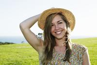Caucasian woman sitting in field