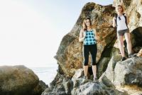 Women hiking on boulders