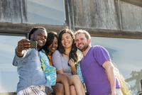 Friends taking selfie outdoors