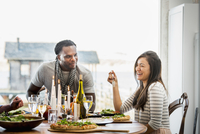 Couple talking at dinner party