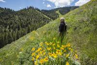 Caucasian woman walking on remote hillside