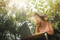 Caucasian woman using laptop outdoors