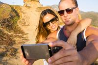 Caucasian couple taking selfie