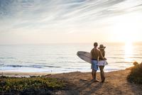 Caucasian couple admiring seascape at beach