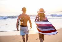 Caucasian couple walking on beach