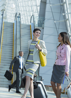 Businesswomen walking in airport