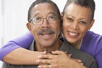 Smiling Black couple hugging