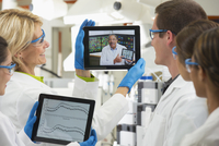 Students videochatting with teacher in laboratory