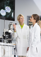 Teacher and student talking in laboratory