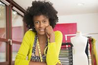 Black dressmaker smiling in studio