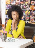 Black businesswoman sitting at desk