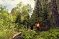 Caucasian hikers walking near mountain