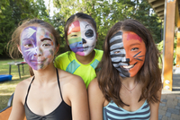 Smiling girls wearing face paint