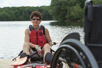 Caucasian paraplegic woman sitting in kayak