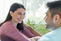 Hispanic couple talking indoors