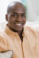 Black man smiling indoors