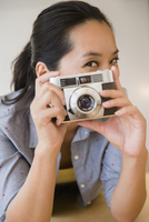 Chinese woman using vintage camera
